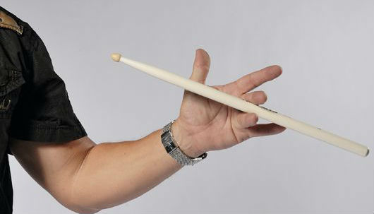 learning various drum stick tricks