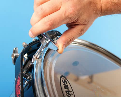 tighten all of the bolts around the face of the drum